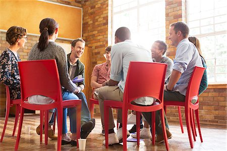 People talking in group therapy session Stock Photo - Premium Royalty-Free, Code: 6113-08088090