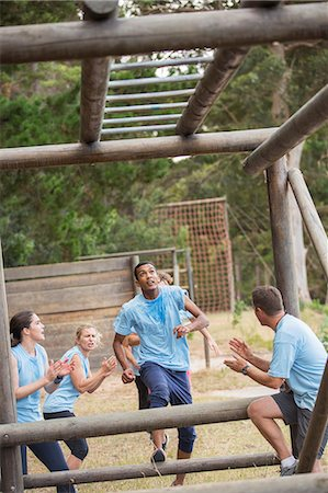 fitness   mature woman - Teammates cheering for man nearing monkey bars on boot camp race course Stock Photo - Premium Royalty-Free, Code: 6113-08088010