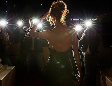 Silhouette of celebrity being photographed by paparazzi Stock Photo - Premium Royalty-Free, Code: 6113-08088144