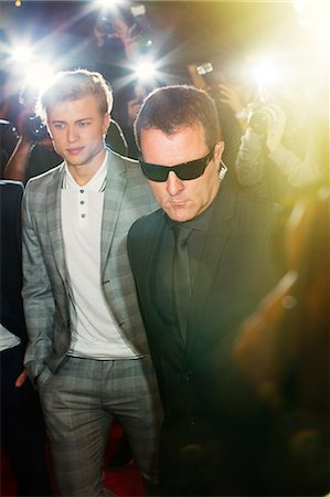rich lifestyle - Bodyguard escorting celebrity at event Stock Photo - Premium Royalty-Free, Code: 6113-08088153
