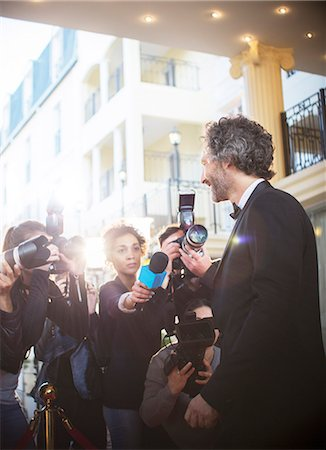 Celebrity being interviewed and photographed by paparazzi at event Stock Photo - Premium Royalty-Free, Code: 6113-08088164