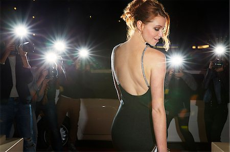 Celebrity in black dress being photographed by paparazzi photographers Stock Photo - Premium Royalty-Free, Code: 6113-08088173