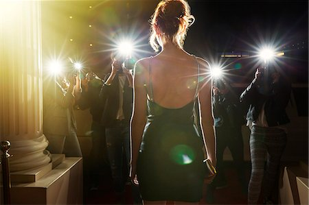 Silhouette of celebrity in black dress being photographed by paparazzi Stock Photo - Premium Royalty-Free, Code: 6113-08088177