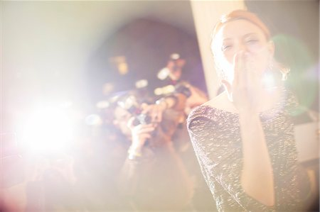 Celebrity blowing a kiss to paparazzi photographers Stock Photo - Premium Royalty-Free, Code: 6113-08088174