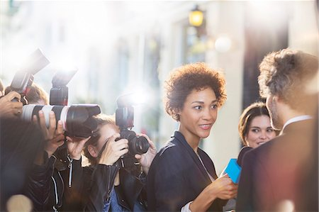 Celebrity being interviewed and photographed by paparazzi at event Stock Photo - Premium Royalty-Free, Code: 6113-08088184