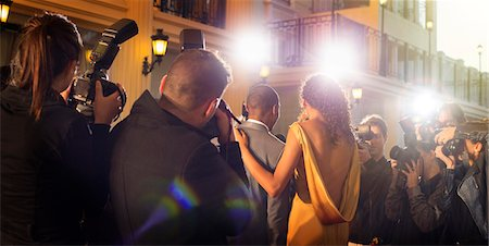 Celebrity couple being photographed at red carpet event Stock Photo - Premium Royalty-Free, Code: 6113-08088240
