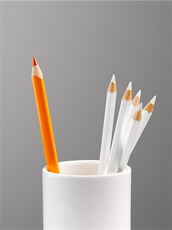 Orange pencil separated in cup with white pencils still life Stock Photo - Premium Royalty-Free, Code: 6113-08088263