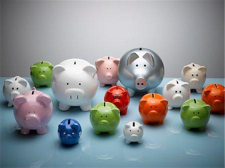 Multicolor piggy banks still life Stock Photo - Premium Royalty-Free, Code: 6113-08088262