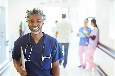 registered nurse - Portrait of smiling doctor in hospital corridor Stock Photo - Premium Royalty-Free, Code: 6113-08088281