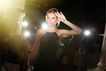Portrait of confident celebrity being photographed by paparazzi at event Stock Photo - Premium Royalty-Free, Code: 6113-08088212