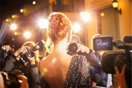 Celebrity being photographed by paparazzi photographers at event Stock Photo - Premium Royalty-Free, Code: 6113-08088218
