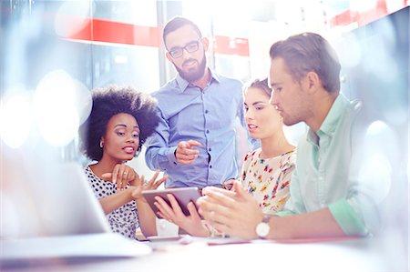Business people meeting around digital tablet Stock Photo - Premium Royalty-Free, Code: 6113-08088504