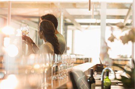 Couple wine tasting in sunny winery tasting room Stock Photo - Premium Royalty-Free, Code: 6113-08171140