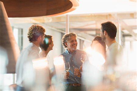 enjoying - Friends wine tasting at winery Stock Photo - Premium Royalty-Free, Code: 6113-08171118