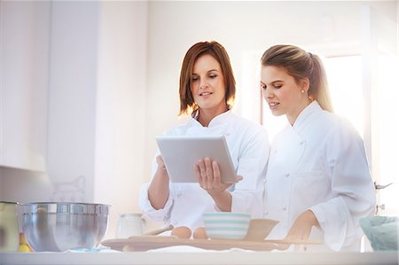 recipe - Chefs using digital tablet in kitchen Stock Photo - Premium Royalty-Free, Code: 6113-08171497