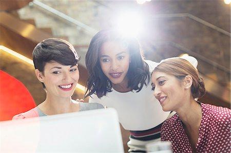 Businesswomen using laptop in office Stock Photo - Premium Royalty-Free, Code: 6113-08184278