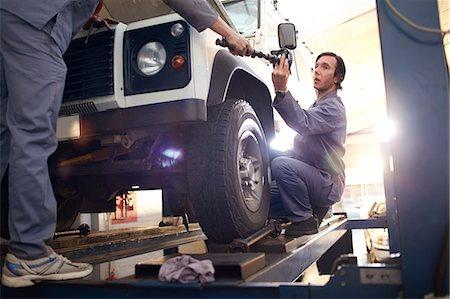 mechanics working in auto repair shop Stock Photo - Premium Royalty-Free, Code: 6113-08184378