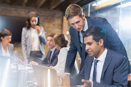 Businessmen working at laptop in conference room meeting Stock Photo - Premium Royalty-Free, Code: 6113-08184308