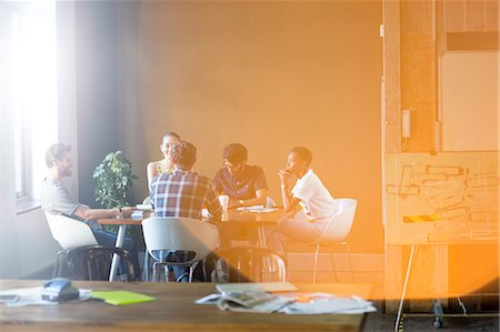 Lens flare over creative business people meeting at office table Stock Photo - Premium Royalty-Free, Code: 6113-08105422