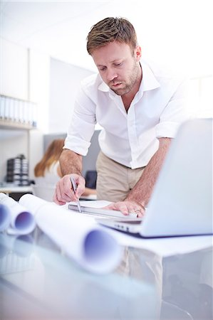 drawing computer - Focused architect drafting blueprint in office Stock Photo - Premium Royalty-Free, Code: 6113-08105510