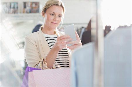 Fashion designer photographing clothing with camera phone Stock Photo - Premium Royalty-Free, Code: 6113-08220298