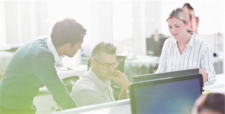 Business people working at computer in office Stock Photo - Premium Royalty-Free, Code: 6113-08220301