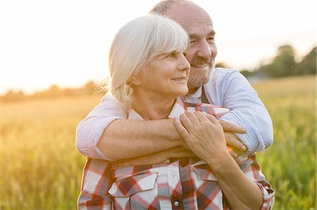 Senior couple hugging in rural wheat field Stock Photo - Premium Royalty-Free, Code: 6113-08220457