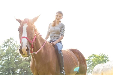 Smiling woman riding horse bareback Stock Photo - Premium Royalty-Free, Code: 6113-08220428