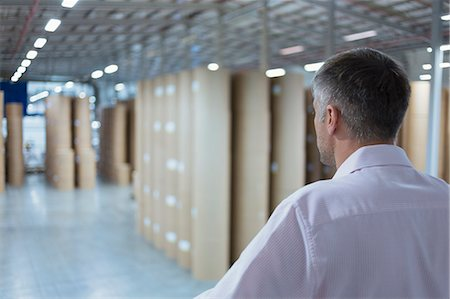 print - Supervisor looking out over warehouse Stock Photo - Premium Royalty-Free, Code: 6113-08393640