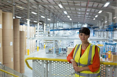 people working in factory - Portrait confident worker on platform above factory Stock Photo - Premium Royalty-Free, Code: 6113-08393651