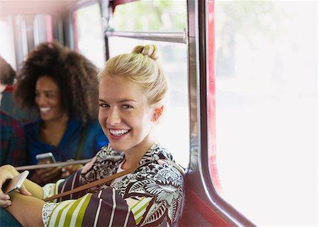 Portrait smiling blonde woman riding bus Stock Photo - Premium Royalty-Free, Code: 6113-08321183