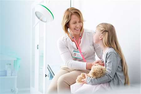 Pediatrician using stethoscope on girl patient in examination room Stock Photo - Premium Royalty-Free, Code: 6113-08321323