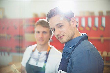 Portrait confident carpenter in workshop Stock Photo - Premium Royalty-Free, Code: 6113-08321471