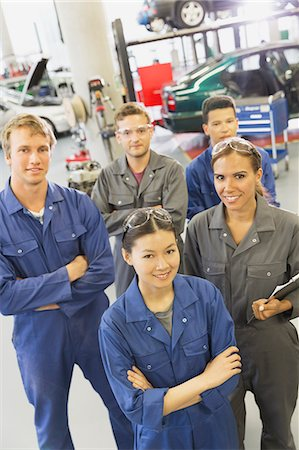 Portrait smiling mechanics in auto repair shop Stock Photo - Premium Royalty-Free, Code: 6113-08321433
