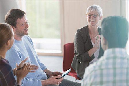 Smiling business people talking in meeting Stock Photo - Premium Royalty-Free, Code: 6113-08321530