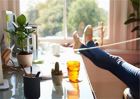 phone cord - Woman talking on telephone with feet up on desk in sunny home office Stock Photo - Premium Royalty-Free, Code: 6113-08321795