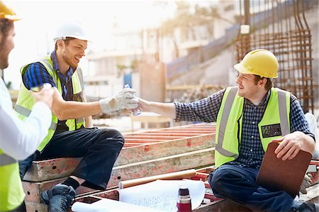 Construction workers and engineer enjoying coffee break at construction site Stock Photo - Premium Royalty-Free, Code: 6113-08321724