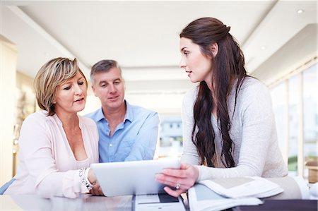 designer - Interior designer using digital tablet in consultation with couple Stock Photo - Premium Royalty-Free, Code: 6113-08424142
