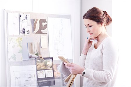 designer (female) - Interior designer viewing swatches in office Stock Photo - Premium Royalty-Free, Code: 6113-08424130