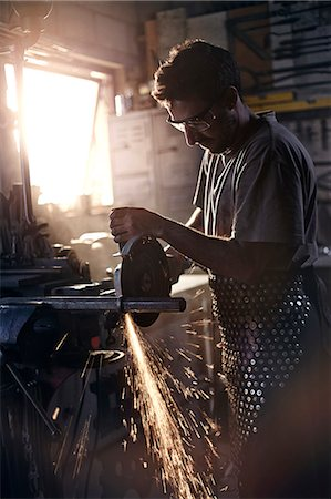 Blacksmith using saw in forge Stock Photo - Premium Royalty-Free, Code: 6113-08424319