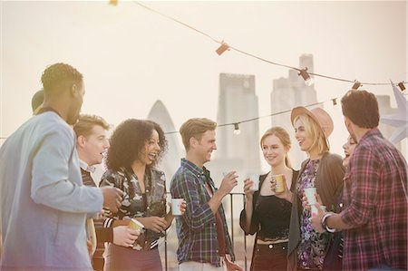 Young adult friends drinking and enjoying rooftop party Stock Photo - Premium Royalty-Free, Code: 6113-08568585