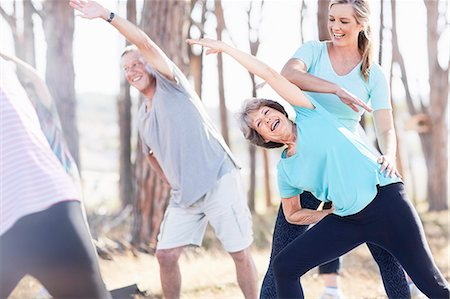 fit people - Yoga instructor guiding senior woman in park Stock Photo - Premium Royalty-Free, Code: 6113-08568742