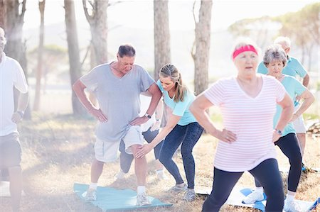 fit people - Yoga instructor guiding senior man in sunny park Stock Photo - Premium Royalty-Free, Code: 6113-08568746