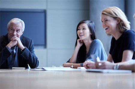 Businesswomen laughing in meeting Stock Photo - Premium Royalty-Free, Code: 6113-08521368
