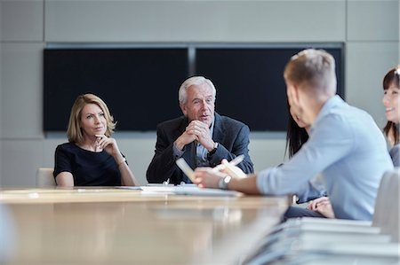 Business people talking in meeting Stock Photo - Premium Royalty-Free, Code: 6113-08521391