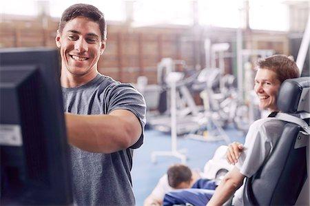 rehabilitation - Physical therapist at computer talking to man Stock Photo - Premium Royalty-Free, Code: 6113-08521465