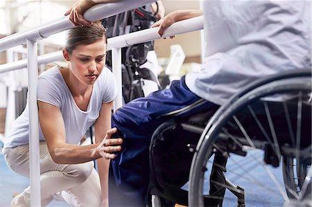 rehabilitation - Physical therapist checking man's knee Stock Photo - Premium Royalty-Free, Code: 6113-08521471
