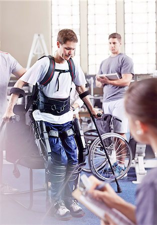 rehabilitation - Physical therapists watching man with forearm crutches standing Stock Photo - Premium Royalty-Free, Code: 6113-08521480