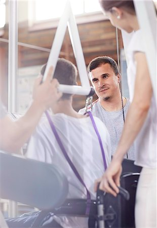 rehabilitation - Physical therapists connecting man to equipment Stock Photo - Premium Royalty-Free, Code: 6113-08521482