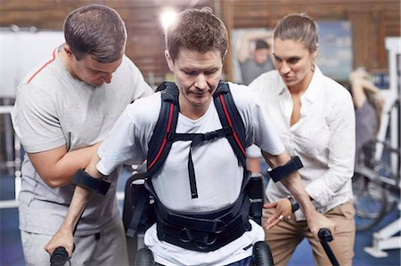 rehabilitation - Physical therapists guiding man walking Stock Photo - Premium Royalty-Free, Code: 6113-08521488